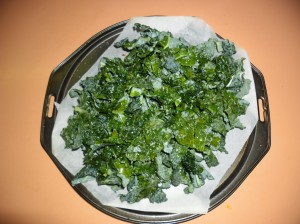 Kale strips, sprinkled with celtic sea salt. Ready to go in the oven.