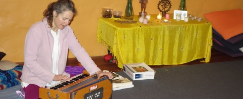 Prema playing harmonium.
