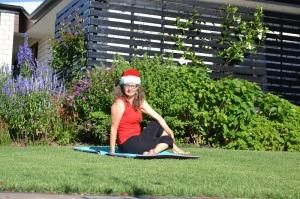 Yoga posture with Christmas hat